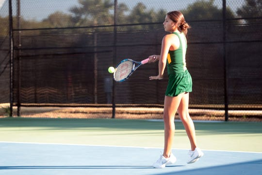Coachella Valley number 3 singles player Lydia Rodriguez returns the ball to Desert Mirage on Tuesday, October 9, 2018 at PGA West in La Quinta.