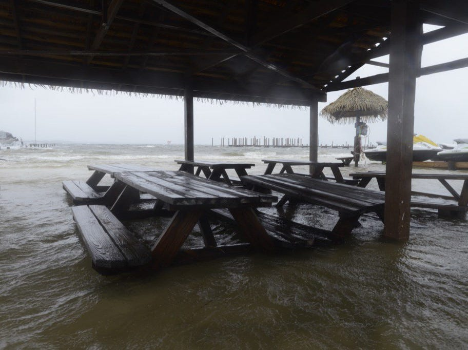 Quietwater Beach sees flooding as Hurricane Michael approaches on Wednesday, Oct. 10, 2018.