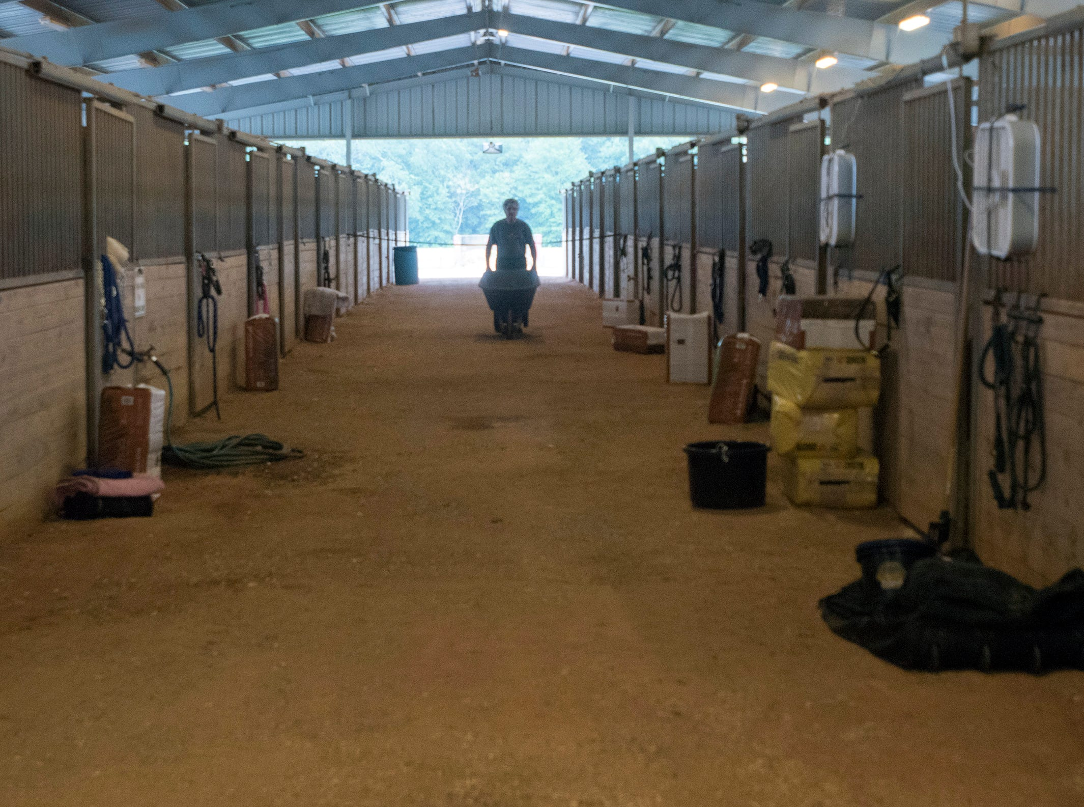 Horses and their owners take shelter Wednesday, Oct. 10, 2018, at the Escambia County Equestrian Center as Hurricane Michael heads toward the Panhandle.