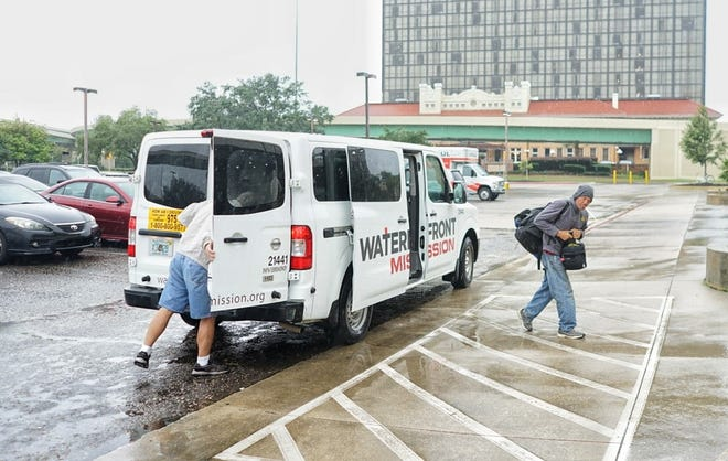 Waterfront Mission moved its residents into the Pensacola Bay Center on Wednesday morning in advance of Hurricane Michael.