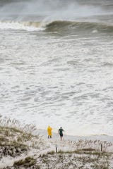 People taking photos of the wave action as Hurricane Michael arrives in Pensacola on Wednesday, October 10, 2018.