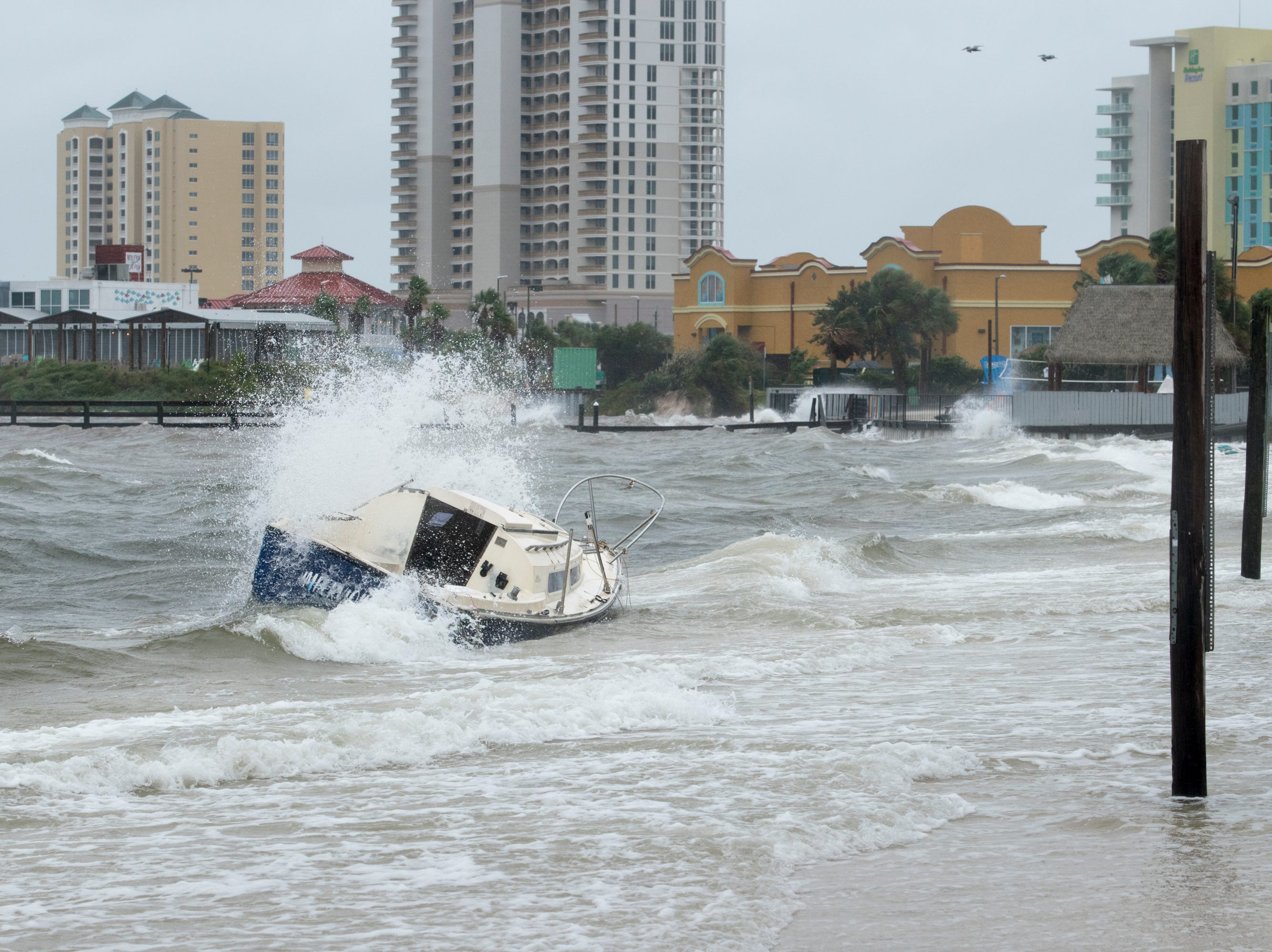 A boat runs aground at Quietwater Beach as Hurricane Michael arrives in Pensacola on Wednesday, October 10, 2018.