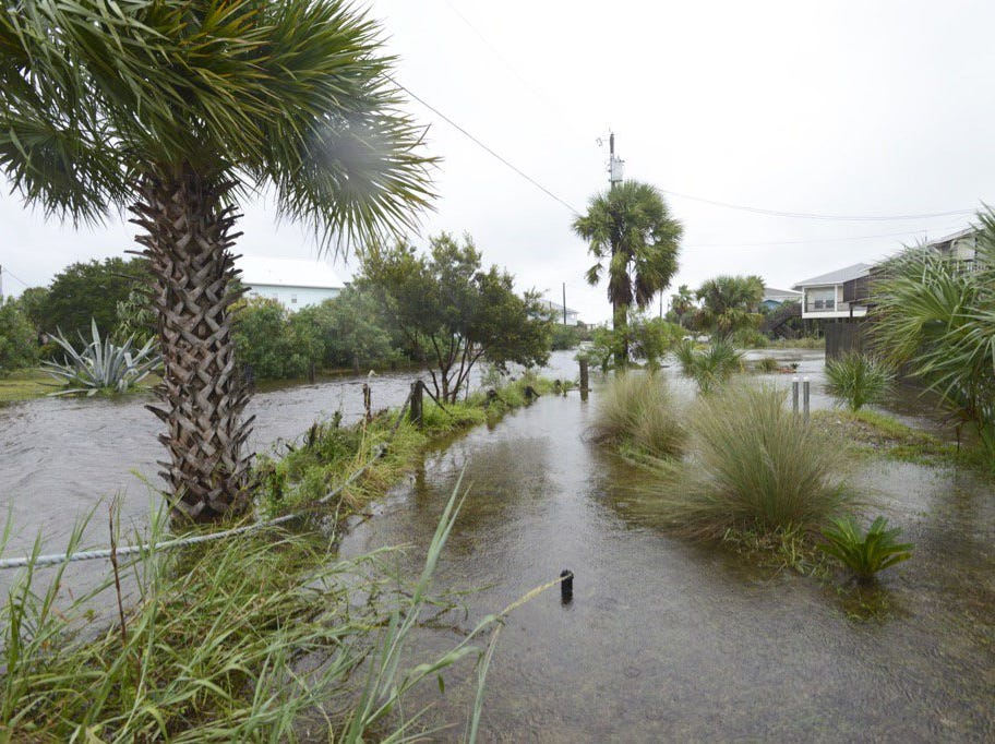 A flooded street at Pensacola Beach as Hurricane Michael arrives.