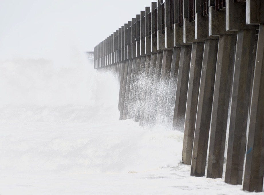 Large waves crash along Pensacola Beach as Hurricane Michael approaches on Wednesday, Oct. 10, 2018.