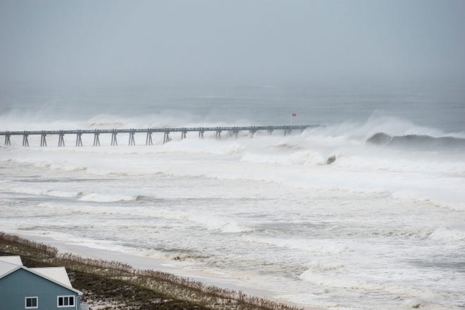 Waves hitting pier as Hurricane Michael arrives in Pensacola on Wednesday, October 10, 2018.