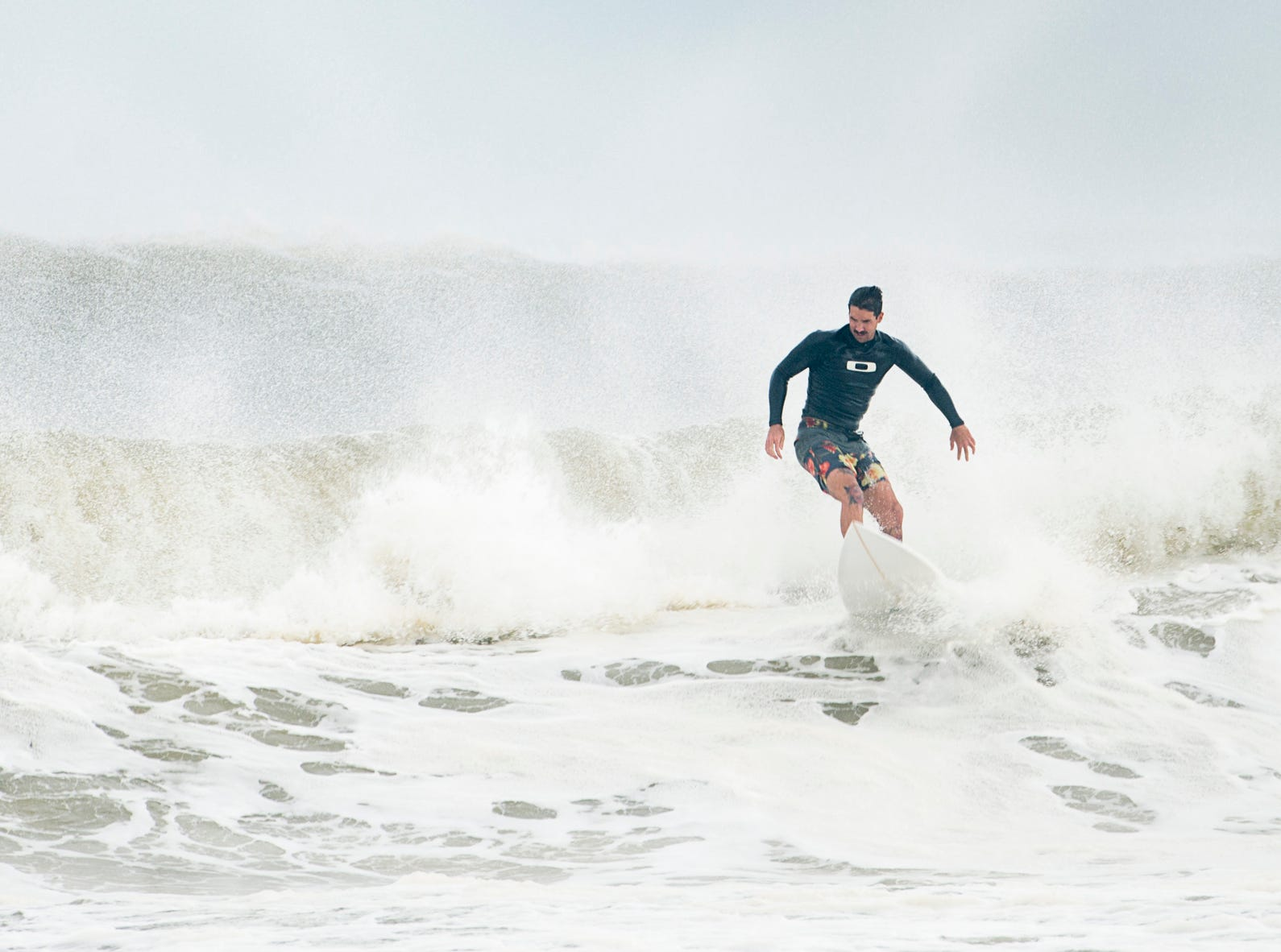 Surfers take advantage of big waves at Casino Beach in Pensacola as Hurricane Michael passes through on Wednesday, October 10, 2018.