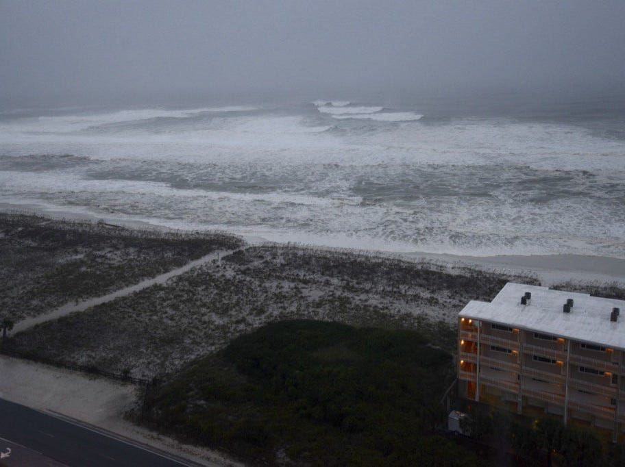 Water reaches the dunes on Pensacola Beach early Wednesday morning as Hurricane Michael approaches.