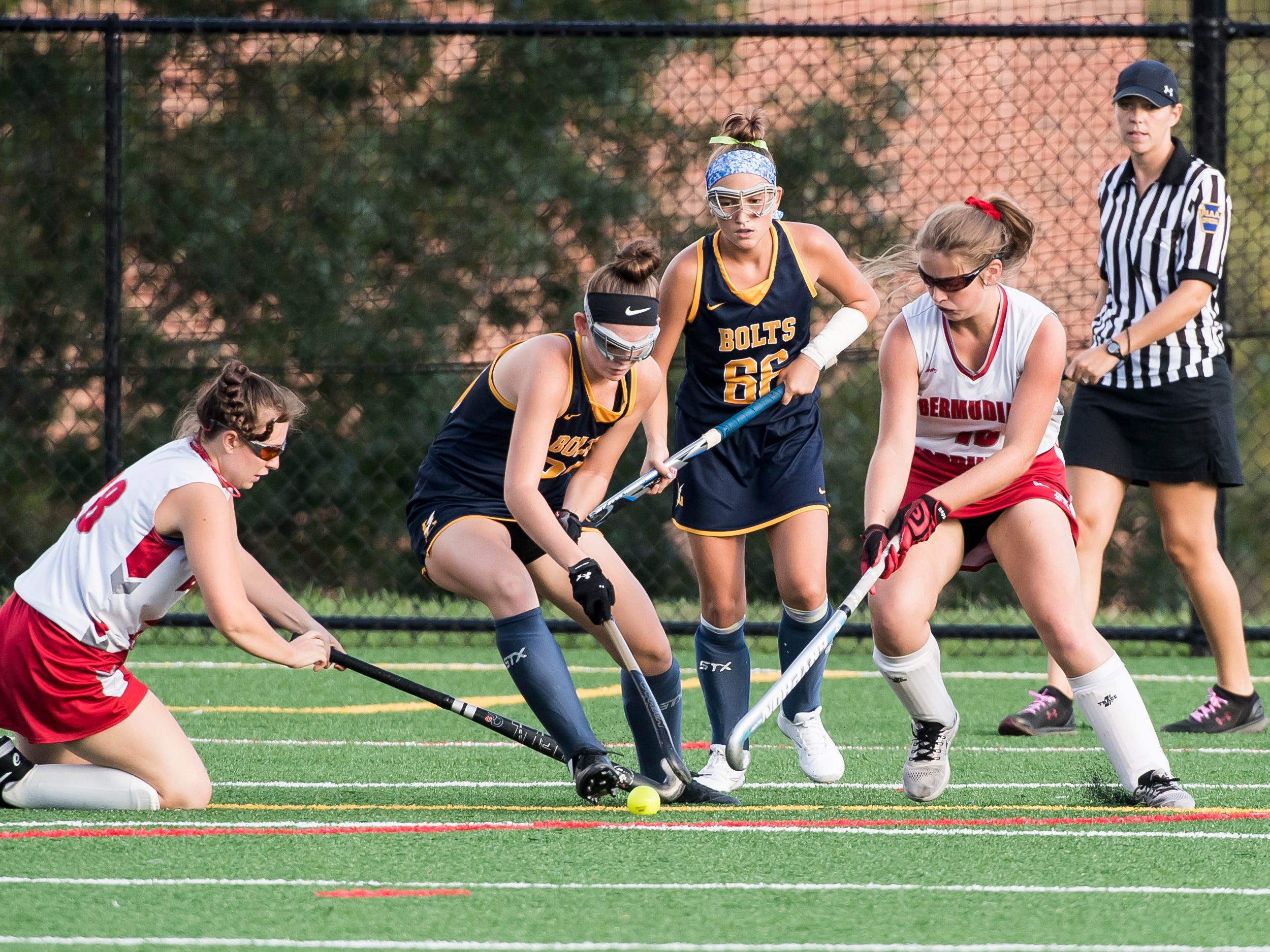 Bermudian Springs and Littlestown field hockey players battle for the ball on Tuesday, October 9, 2018. The Eagles won 4-0.