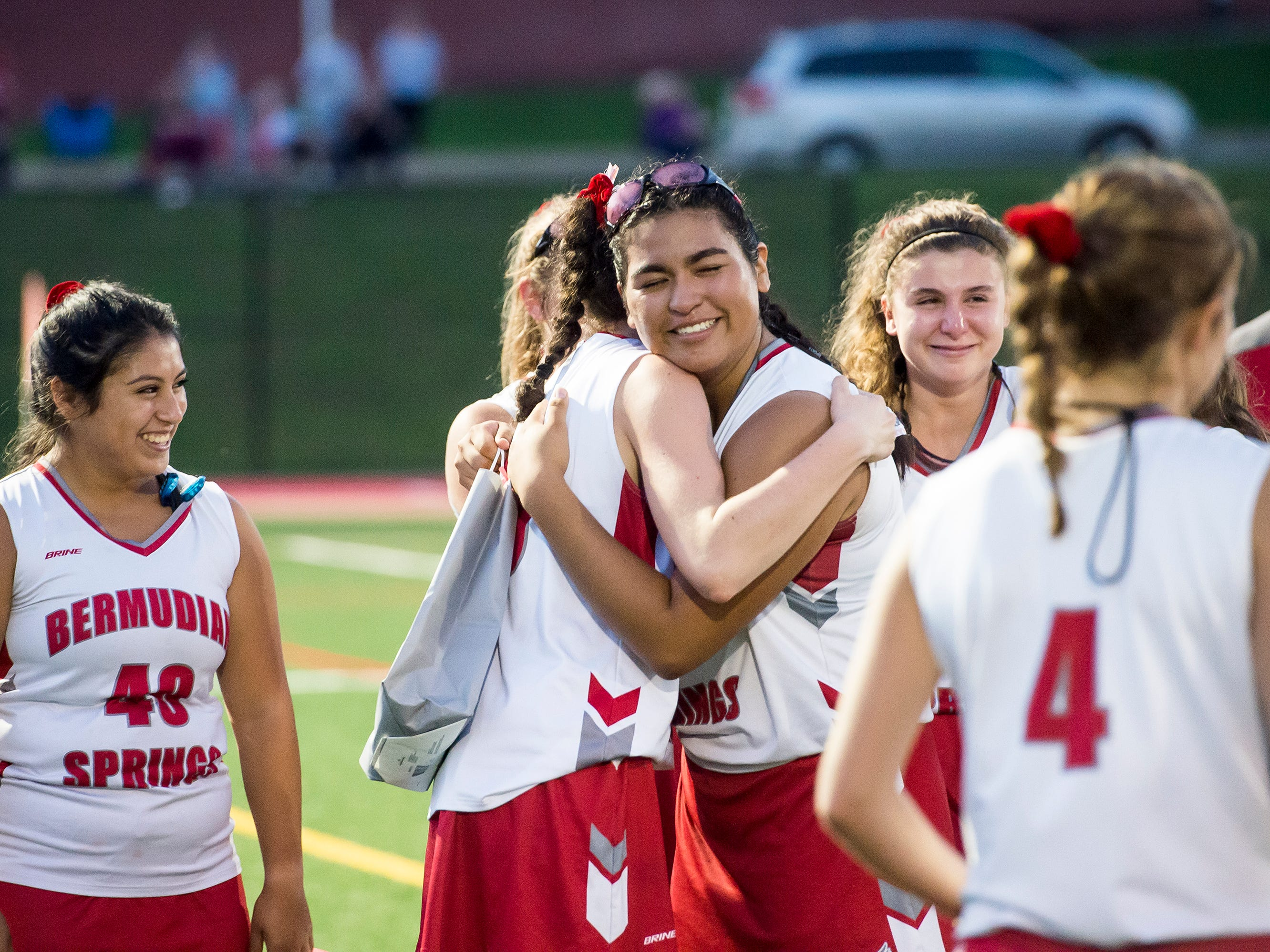 Bermudian Springs senior Jenn Garcia gets a hug from teammate Lillian Peters following a senior night ceremony on Tuesday, October 9, 2018.