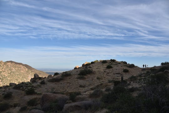 Hikers take a break at the Vulture View scenic point.