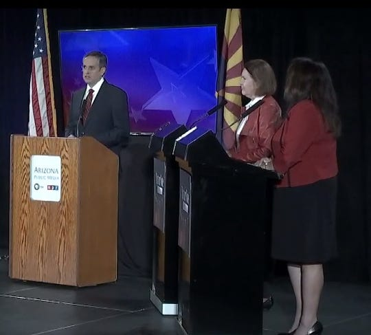 Arizona 2nd Congressional District candidates Ann Kirkpatrick (center) and Lea Marquez Peterson (right) debate in Tucson on Tuesday, Oct. 9, 2018.