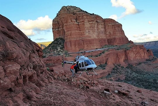 A helicopter rescue team rescues a woman on Oct. 3 from Bell Rock, Sedona after she wandered off the path and could not get down.