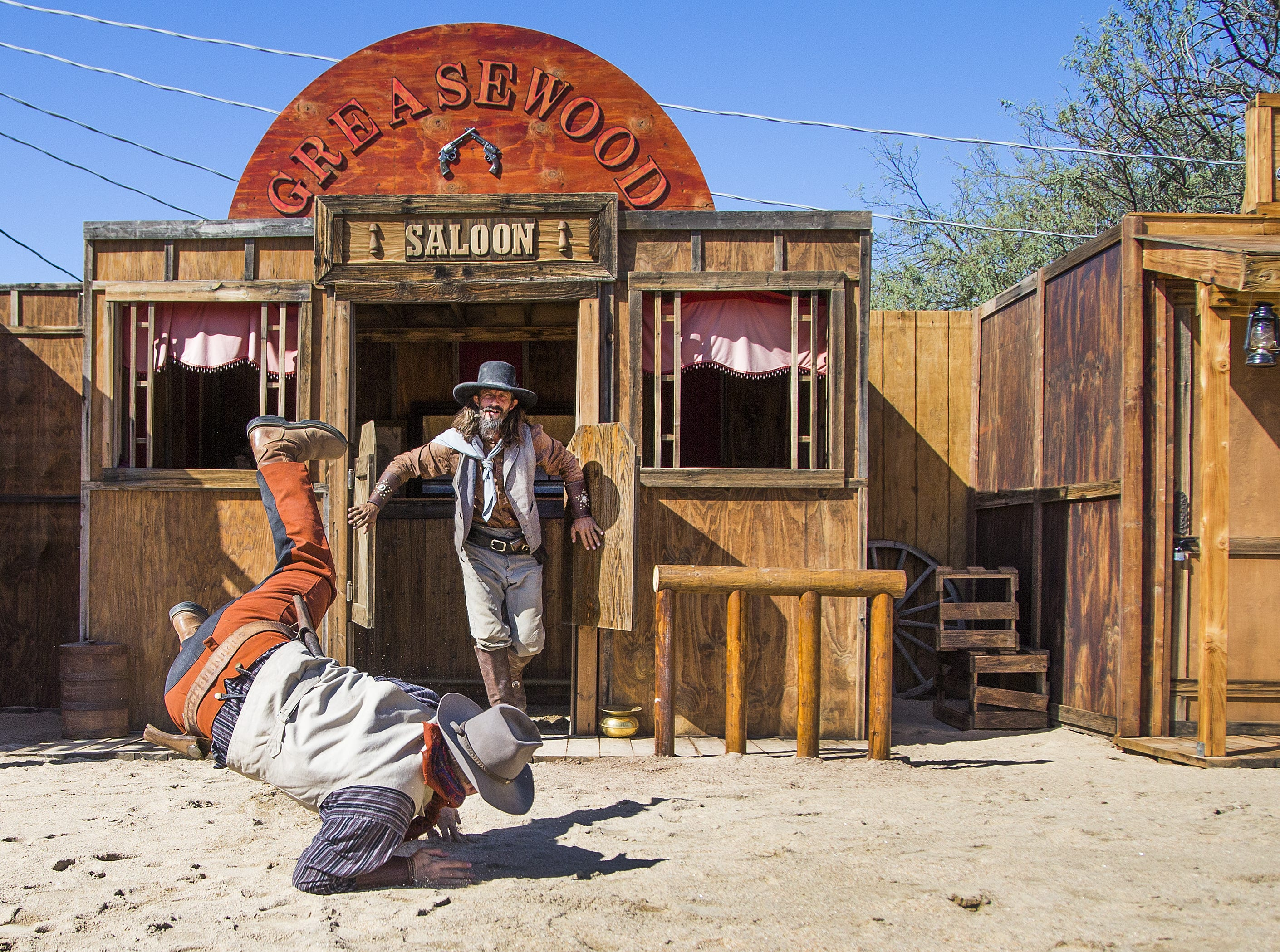 Actors with Six Gun Entertainment re-enact a bar fight during their Wild West stunt show at Frontier Town in Cave Creek, Tuesday, Oct. 9, 2018.