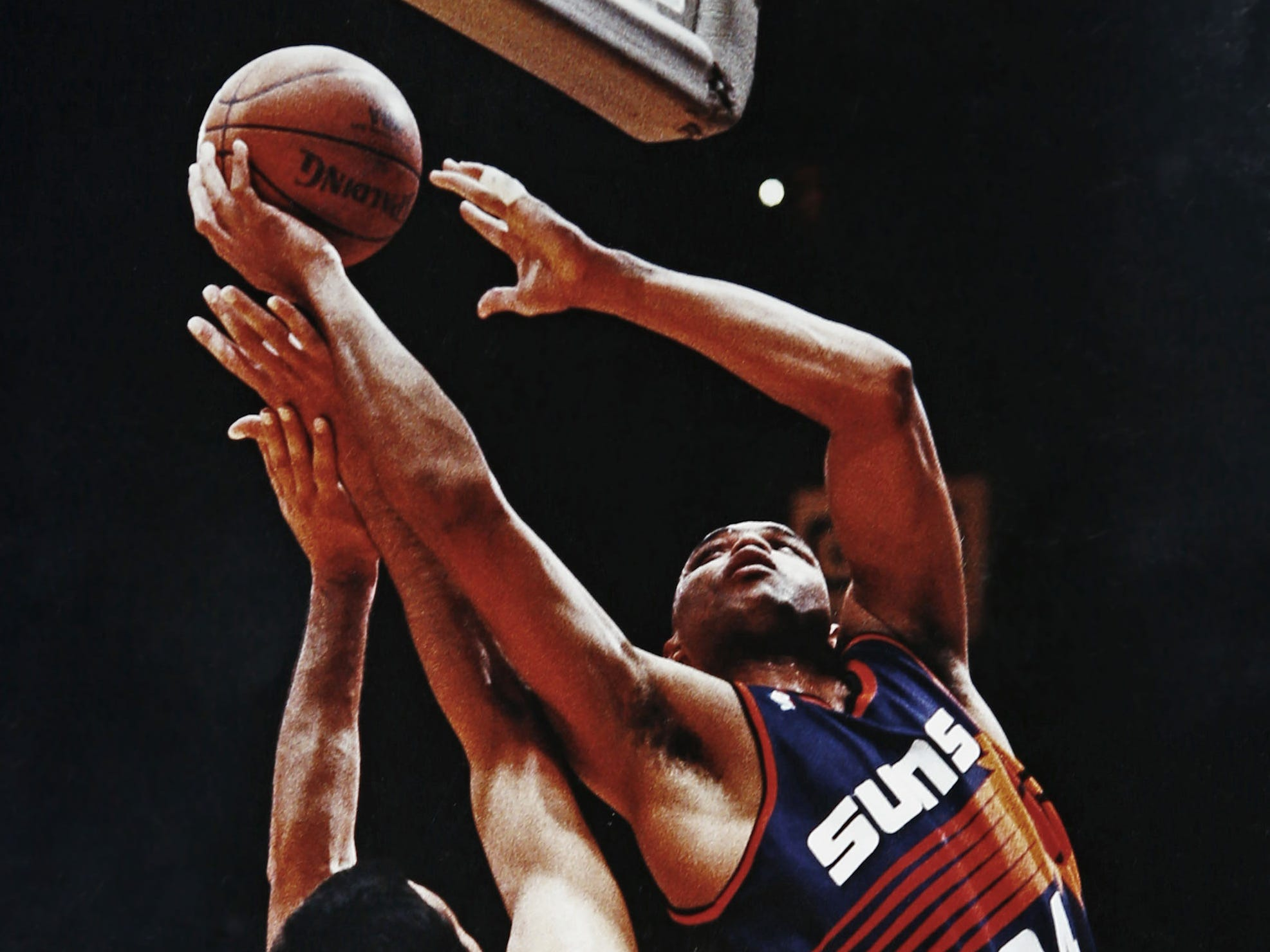 Charles Barkley scores over the Lakers' Vlade Divac during the 1993 NBA Playoffs in Los Angeles.