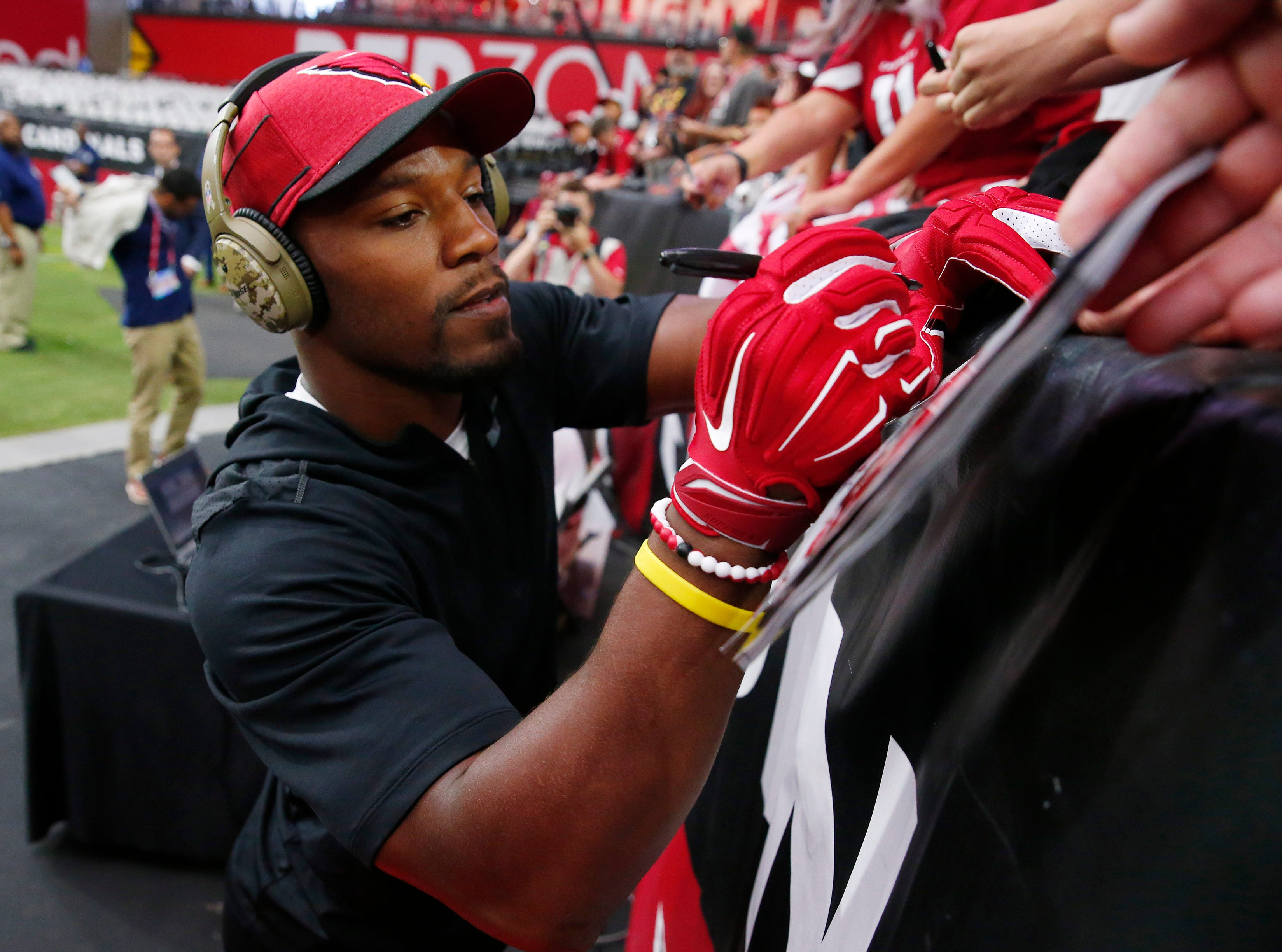 Arizona Cardinals running back David Johnson (31) signs autographs before NFL action against the Chicago Bears at State Farm Stadium in Glendale, Ariz. September 30, 2018.
