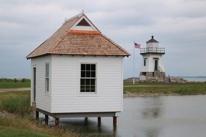 The replica of a 1902 boathouse has moved into its permanent location on the water in the Derby Pond at Waterworks Park near the Port Clinton Lighthouse.