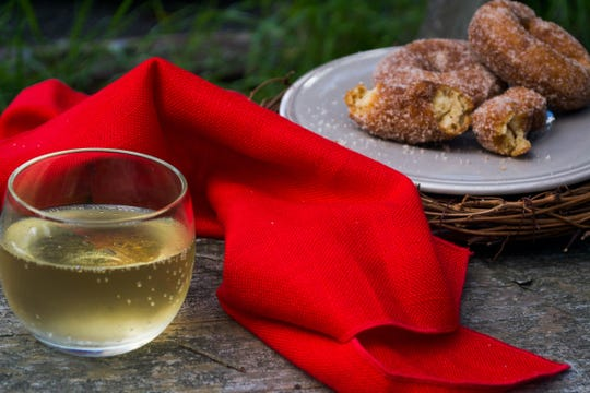 Pair Bad Seed's hard cider with freshly made apple cider doughnuts at Wilklow Orchards in Highland.