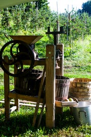 An apple cider mill at Locust Grove Fruit Farm in Milton is a seasonal attraction.