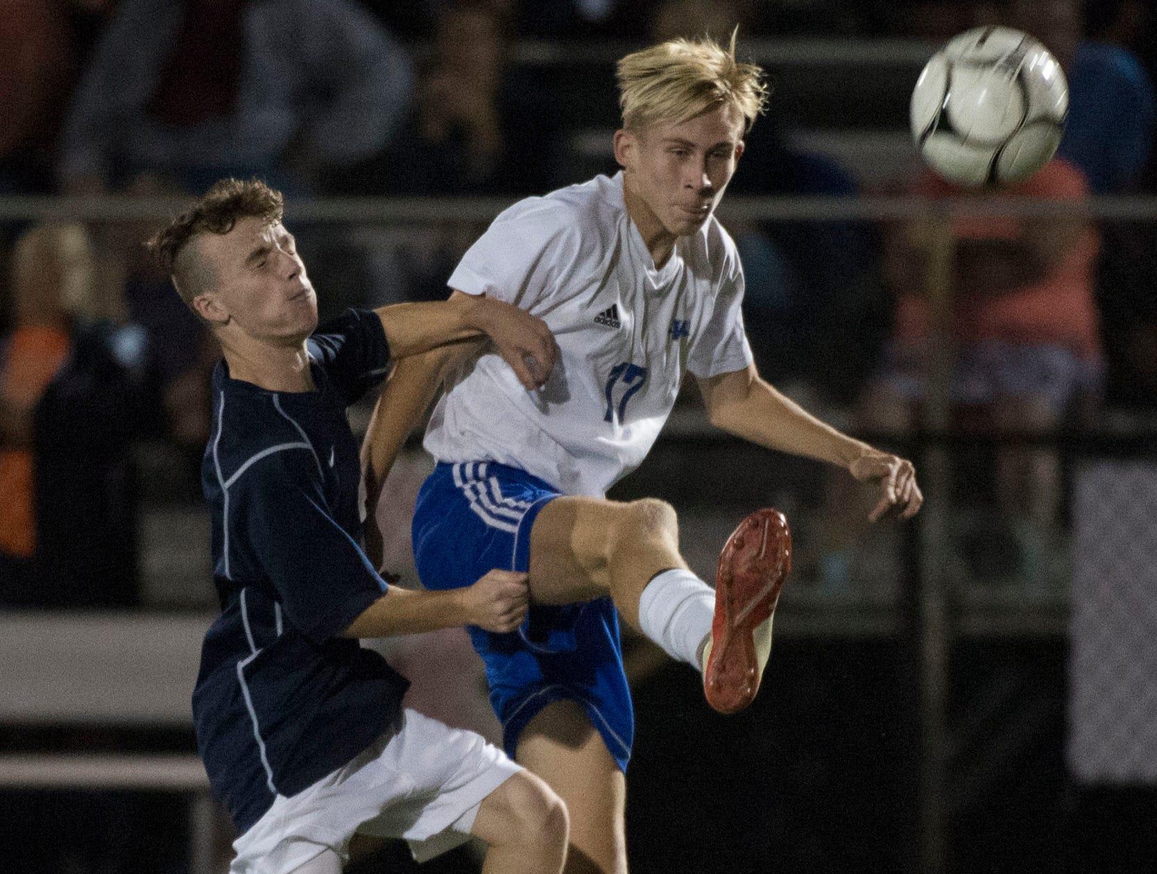 Waynesboro's Tyler Hanosek, right, kicks the ball away from Greencastle's Tanner Martin. Waynesboro shocked Greencastle with a 4-0 shutout in PIAA Mid-Colonial soccer on Tuesday, Oct. 9, 2018.