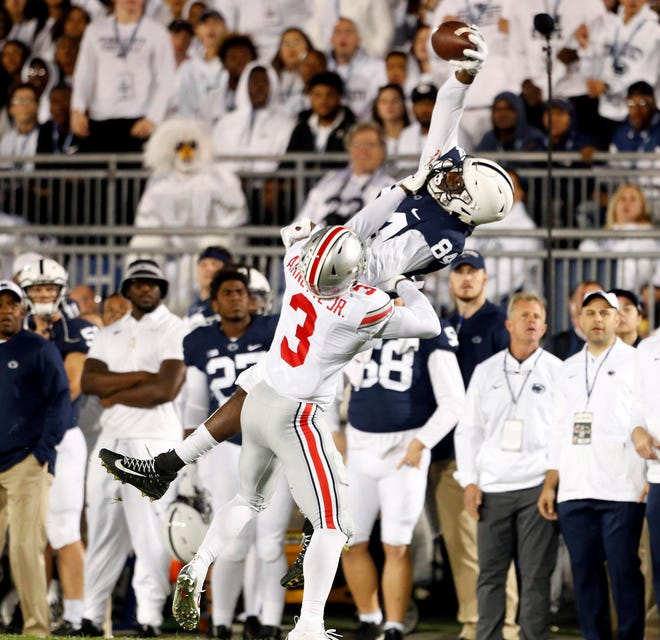 Penn State's Juwan Johnson makes a one-handed catch against Ohio State. Johnson, however, has had some difficulty making the easier catches this season. AP FILE PHOTO