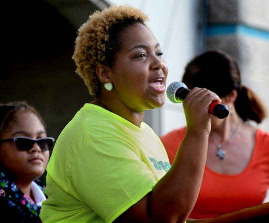 Lincoln Charter School Board President and York City Council member Edquina Washington speaks during a rally while celebrating the 22nd annual National Walk to School Day Wednesday, Oct. 10, 2018. Students, accompanied by the school's Drum Lions drum corps, marched a route near the school and held the rally in its courtyard. Over 5,000 U.S. schools participated in the event which promotes health, safety and community. Bill Kalina photo
