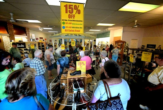 Customers flock to Reineberg's Shoes & Shoe Repair during the first day of the store's closing sale Wednesday, Oct. 10, 2018. The Springettsbury Township store is closing after 141 years in business. Bill Kalina photo