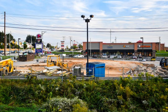 The new Taco Bell will be surrounded by a car wash and Little Caesars among other businesses.
