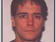 Michael Edward Akerly, wanted for a 1998 rape and aggravated indecent assault in Erie