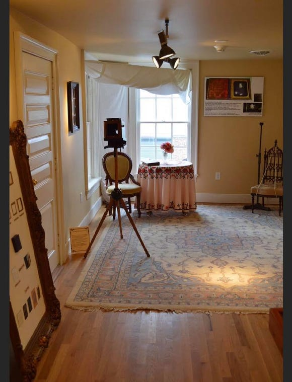 This replica photo studio at the Goodridge center is set up in the room that is believed to be the place in which Glenalvin Goodridge practiced his craft in the mid-1800s. Light was crucial in early photography, and notice that chair for portraits is set up between the two windows. That's also a replica tablecloth, similar to one appearing in Goodridge's photos.