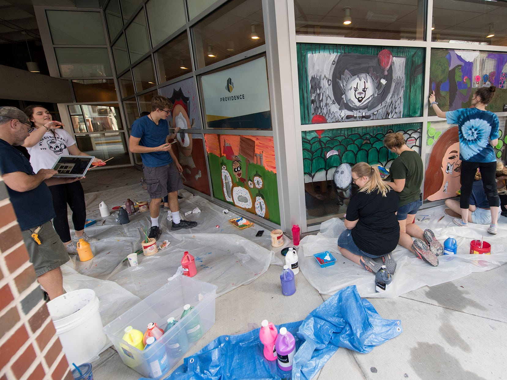 Red Land High School students paint a Halloween display in downtown York Wednesday October 10, 2018.
