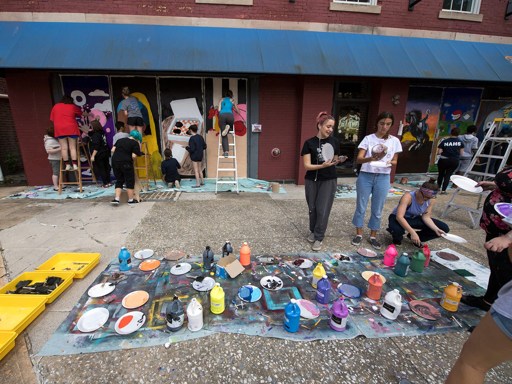 Dallastown students paint Halloween windows on Continental Square in downtown York Wednesday October 10, 2018.