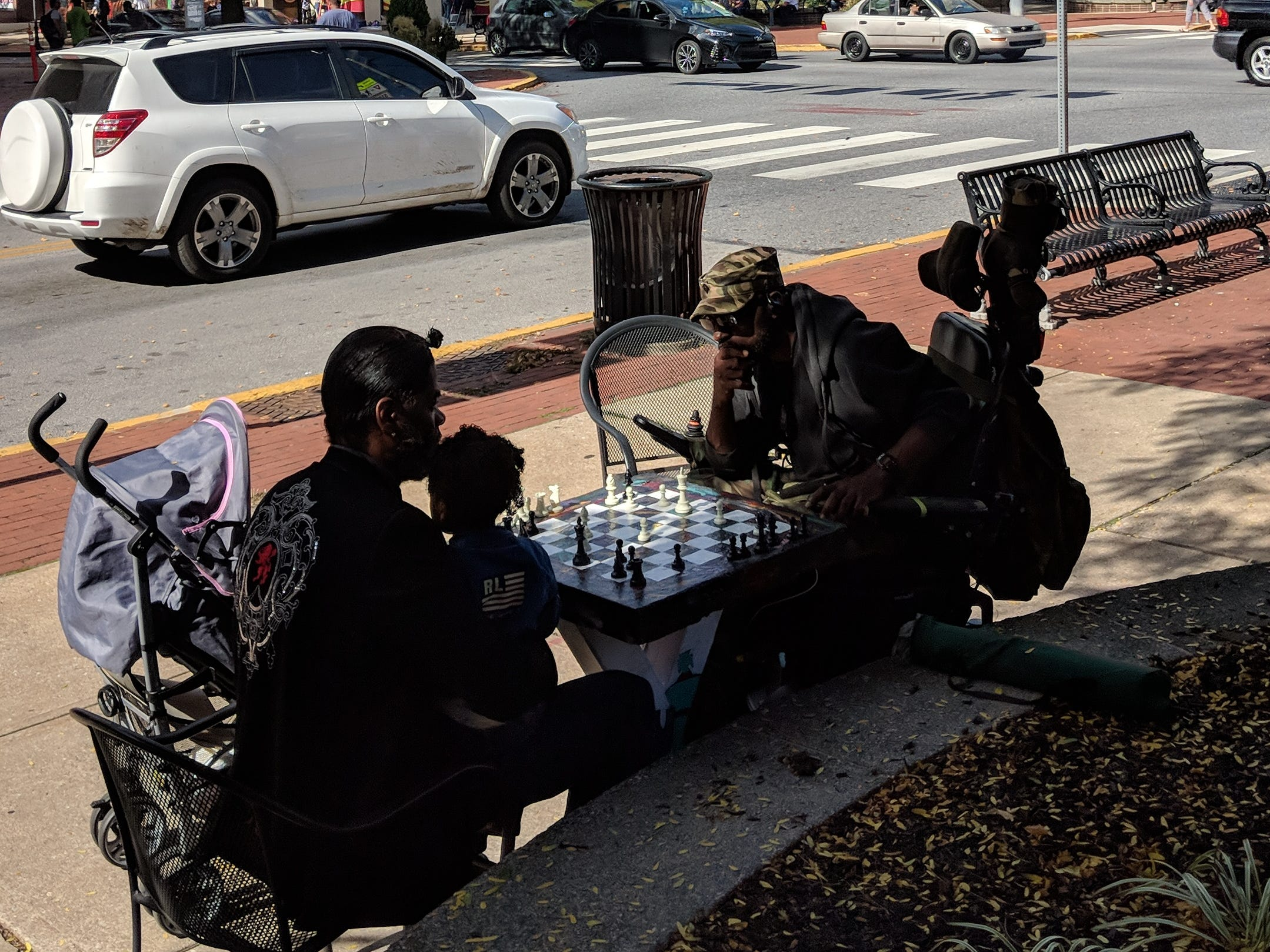 Kevin 'Po' Bertram, left, plays a game of chess with friend Smitty on Continental Square in York on one of the permanently installed chess boards.