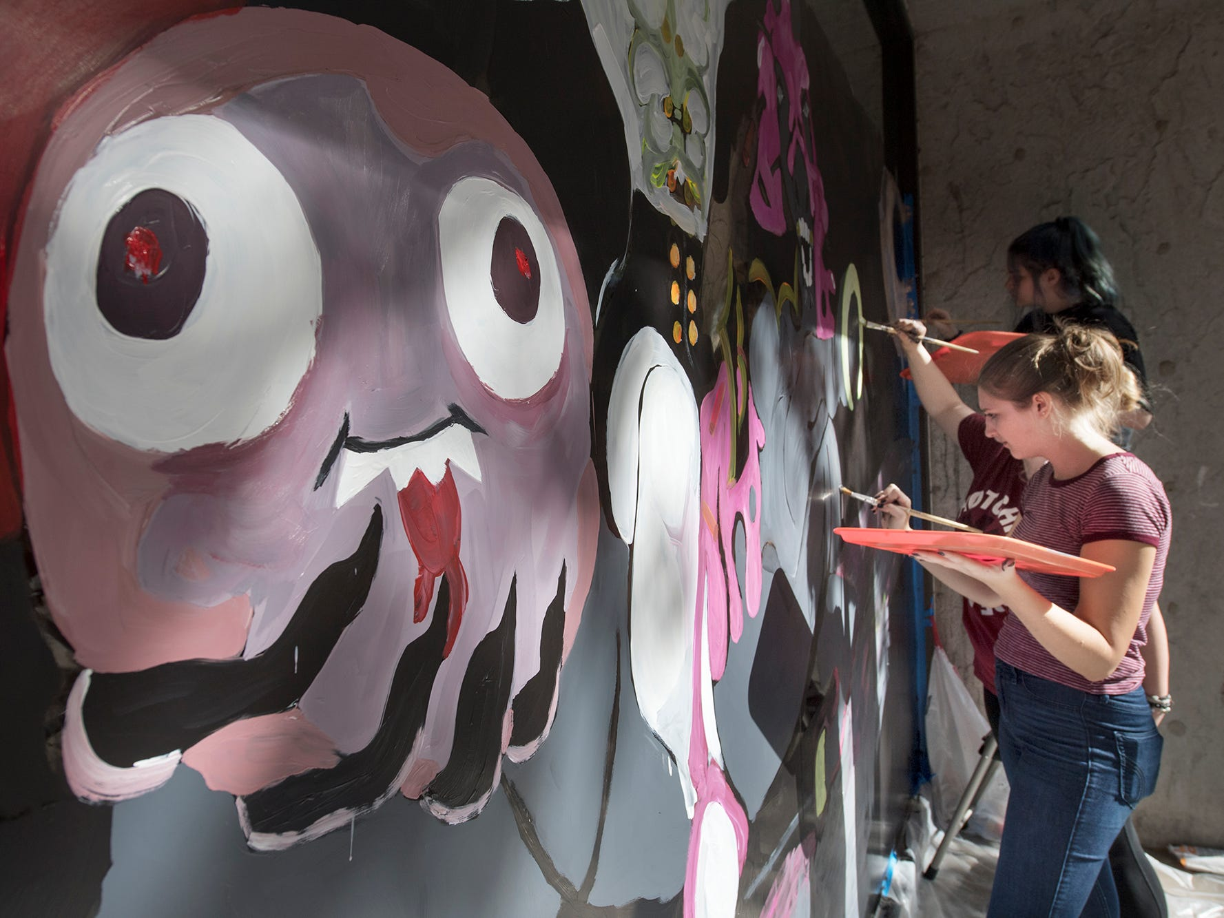 Central York students paint a Halloween window display in downtown York.