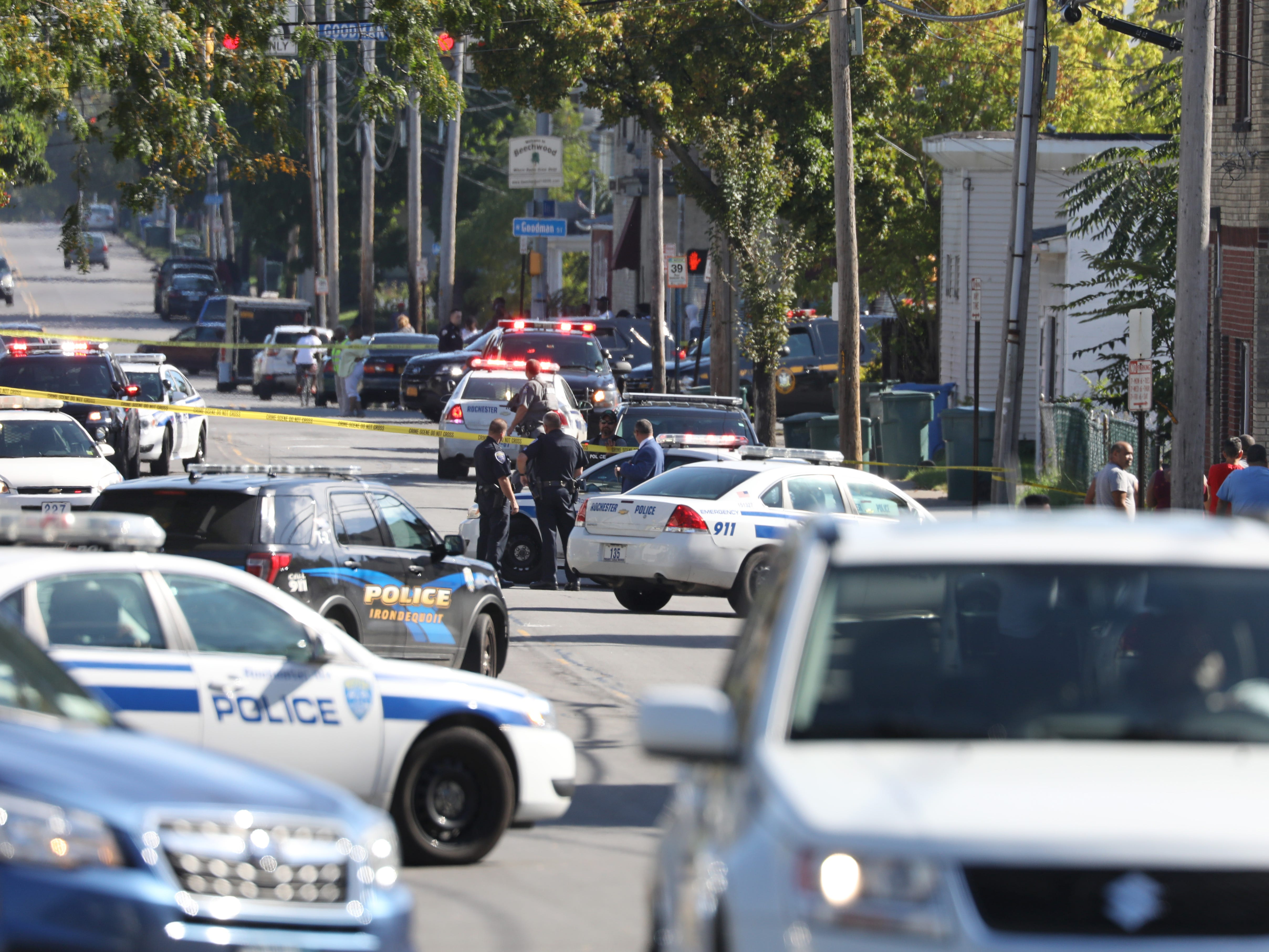 Rochester and Monroe County Police swarm Bay Street near Frances Street following a police chase and shoot out in Rochester Wednesday, Oct. 10, 2018.