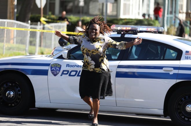 Juliet Blake-Lavan, aunt of shooting suspect arrive at scene on Bay Street.