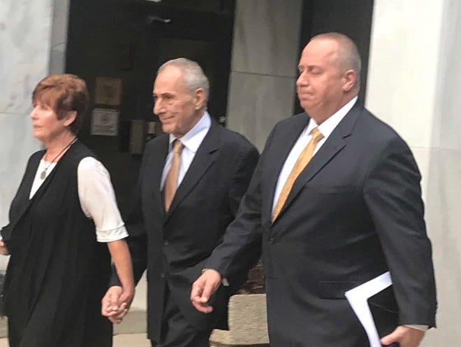 Assemblyman Joseph Errigo, center, leaves court Wednesday.