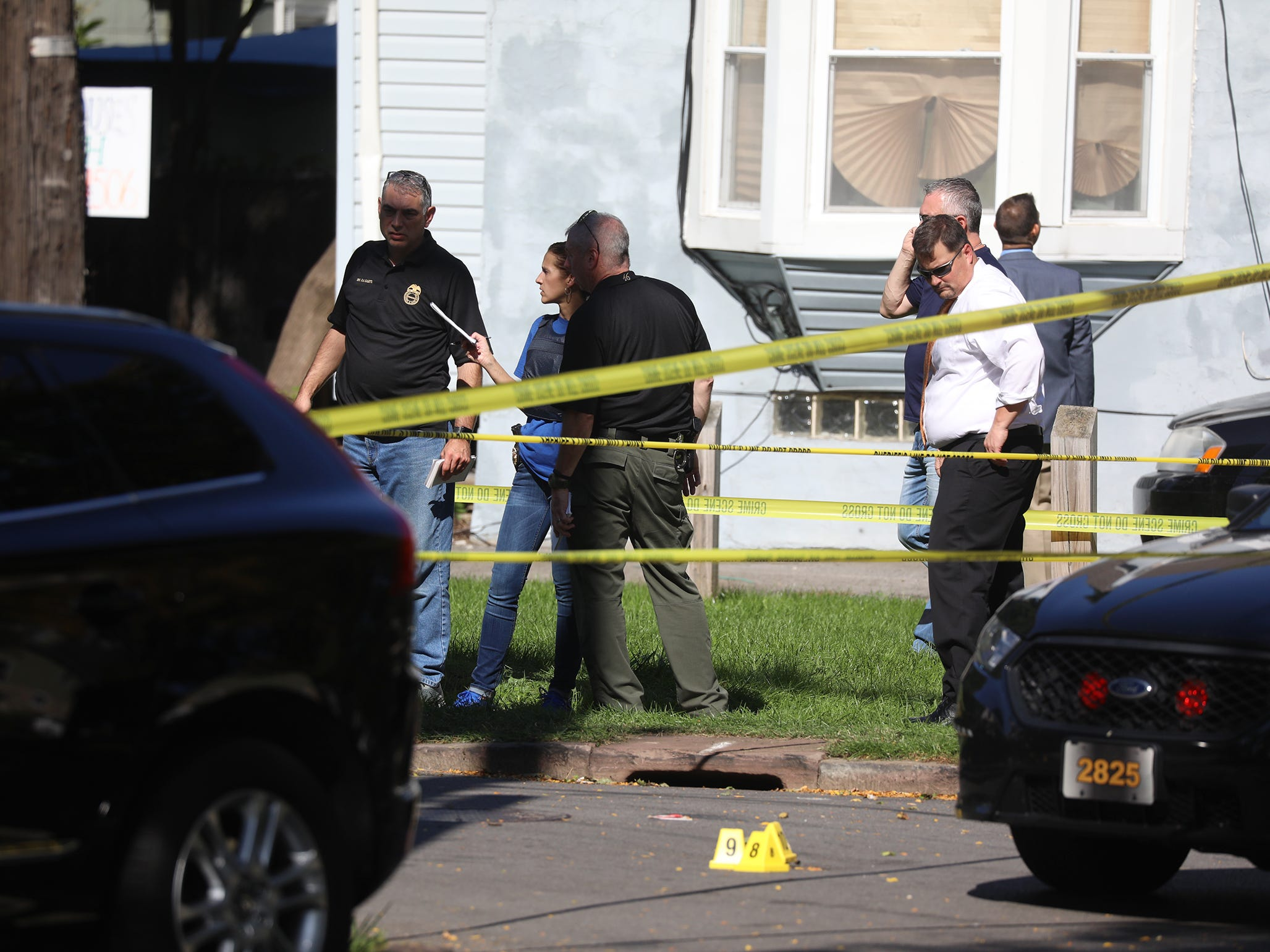 Perry Duckles, assistant district attorney for Monroe County, looks down towards the evidence cones on Forester St.  Police were involved in a shooting with a suspect in an earlier shooting.