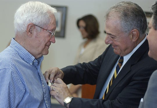 State Assemblyman Joe Errigo, right, pins the Conspicuous Service Cross on Edwin Kinnen, Pittsford, during a special ceremony held to honor local war veterans with military awards sanctioned by New York State Thursday, August 2, 2007, at the Pittsford Community Library in Pittsford.