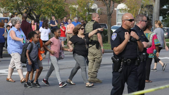 Students are released to their parents from School No. 25 on N. Goodman Street following a lock down brought on by a shooting in Rochester Wednesday, Oct. 10, 2018.