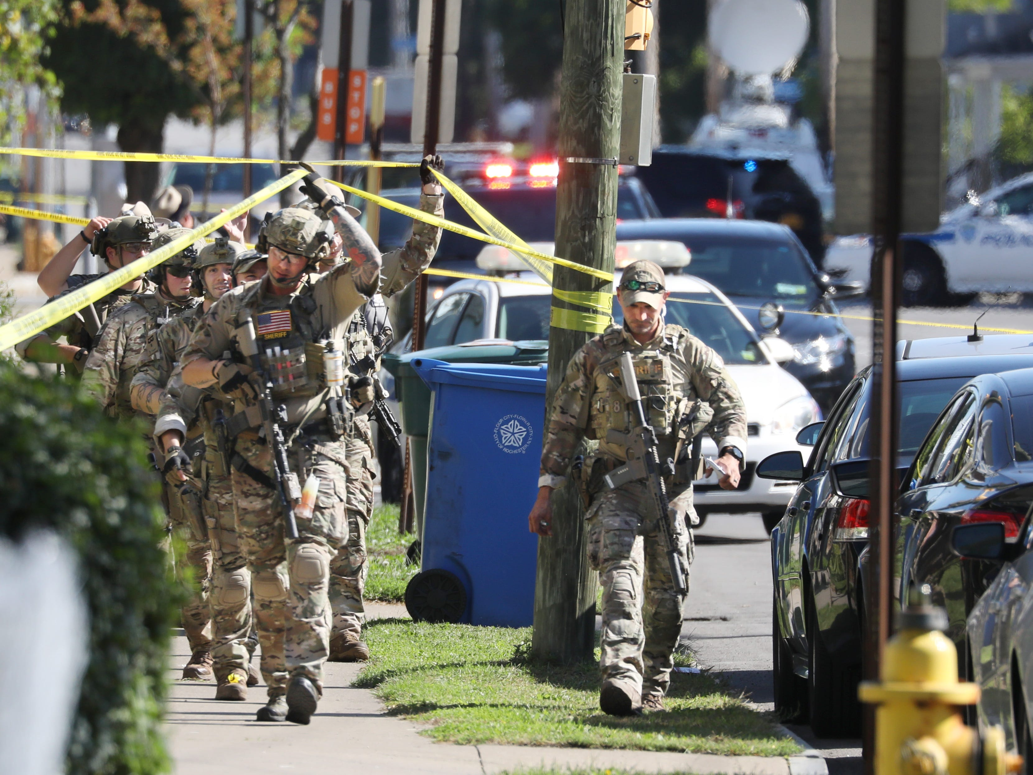 Monroe Country Sheriff's tactical unit moves down Bay Street following a shoot out between a shooting suspect and Rochester Police in Rochester Wednesday, Oct. 10, 2018.