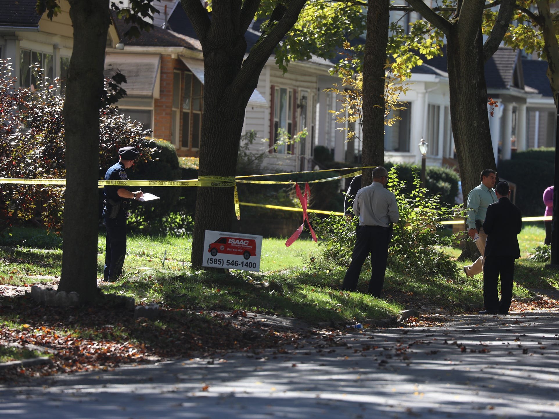 Police investigate the shooting on Post Ave. that left one dead and one injured.