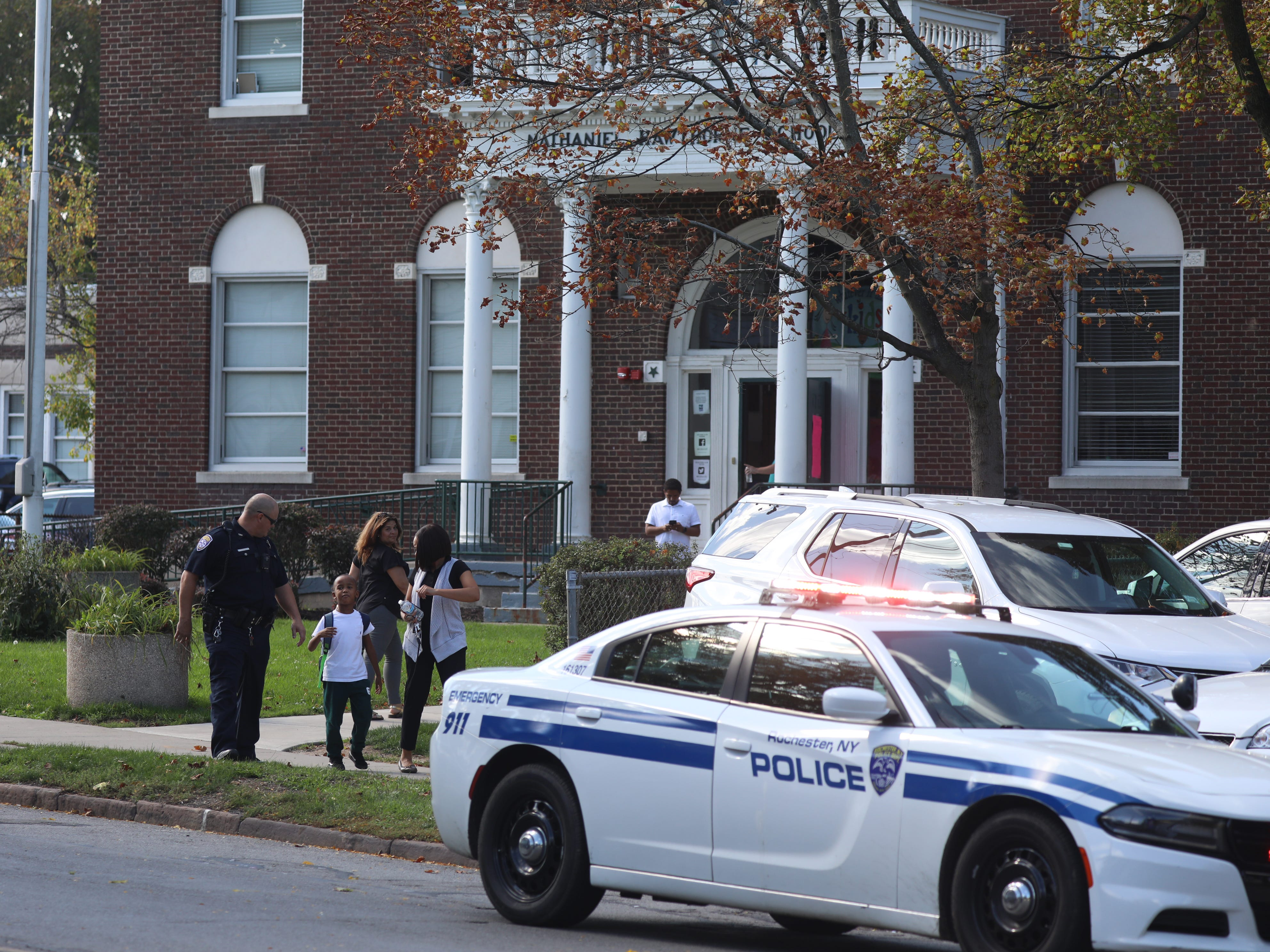 Children were released from School 25 early to parents after a shooting in the area between police and a suspect.