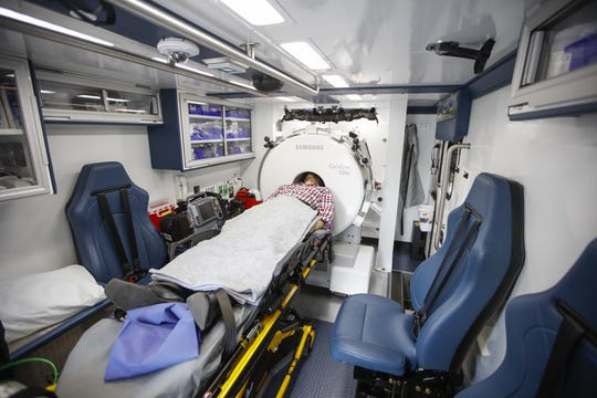 In this simulation, a patient suspected of having a stroke receives a CT scan in the mobile stroke unit. The rig's crew includes a stroke nurse and a CT technologist.