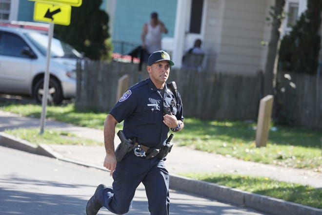 Rochester Police race to the scene at Bay Street near Frances Street following a police chase and shoot out in Rochester Wednesday, Oct. 10, 2018.