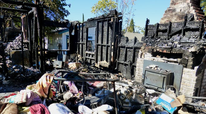 A fire that killed an elderly Cottonwood woman Sunday left her Willow Street home in ruins.