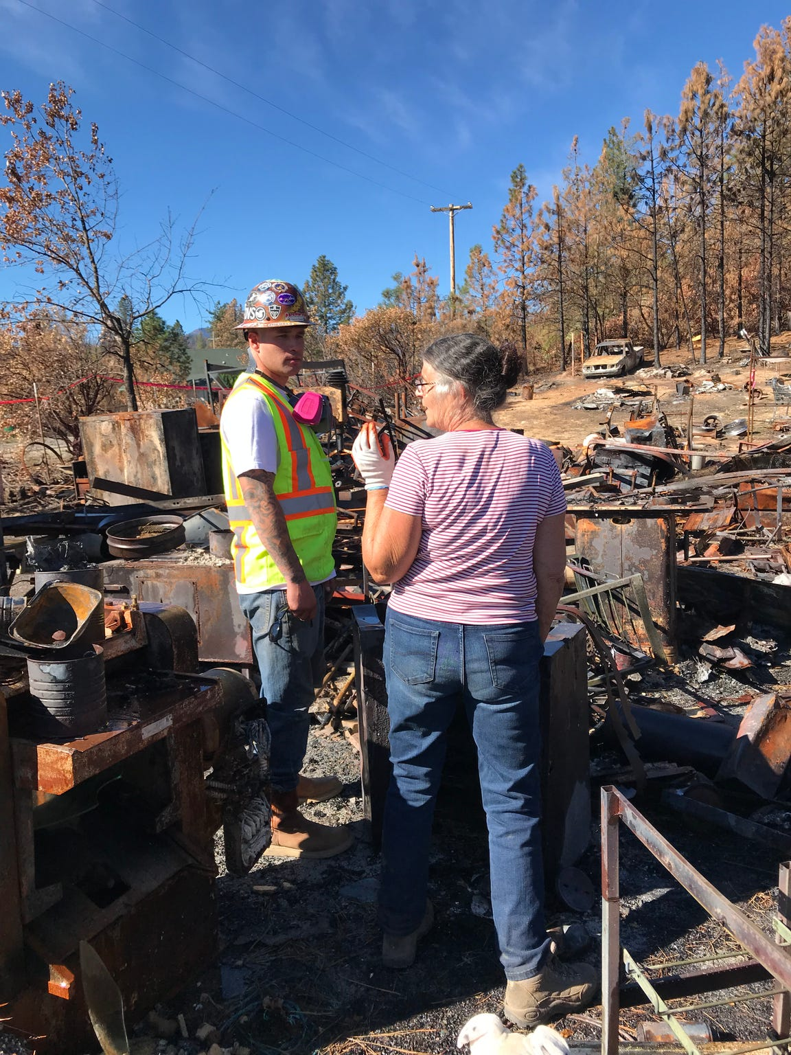 Marci Fernandes asks a CalRecycle worker clearing her property to save some equipment that belonged to her late husband, Larry Allen.