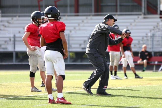 North Salem football head coach, Jeff Flood, practices with his team for their game against Central on Tuesday, Oct. 9, 2018 at North Salem High School.