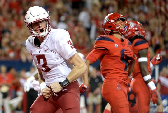Washington State Cougars quarterback Tyler Hilinski (3) celebrates after scoring a touchdown against the Arizona Wildcats during the first half at Arizona Stadium.