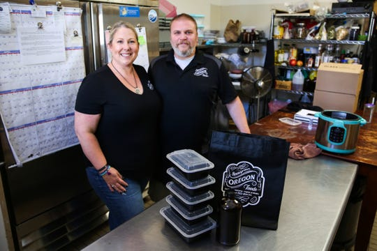 Shawna Dugger and her husband Chris Dugger prepare food for their meal prep business on Wednesday, Oct. 10, 2018 at Home Grown Oregon in Albany.
