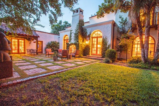 This view of the courtyard and guest house at 1107 Montecito Drive reveal more of the Mediterranean theme.